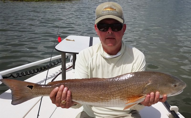 Peter with 13 lb red fish